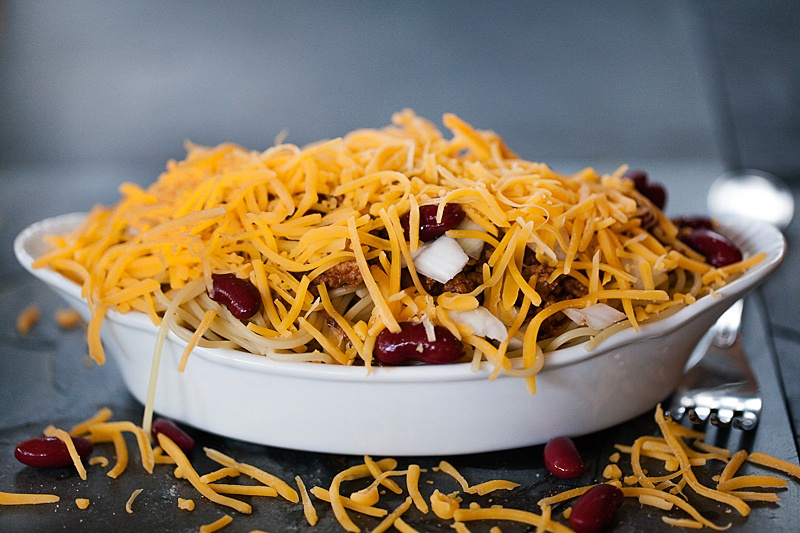 Cincinnati Turkey chili made with turkey topped with cheese, onion, red kidney beans and hot sauce