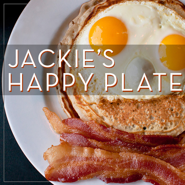 A happy plate of smiling pancakes eggs and bacon