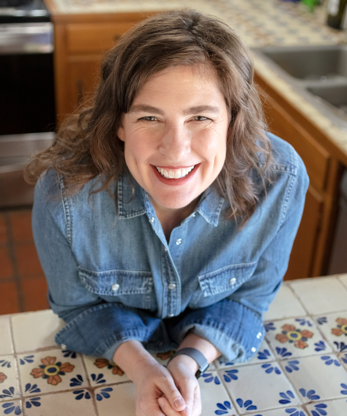 Portrait of Taste of Tucson Cookbook author in her Mexican tiled kitchen