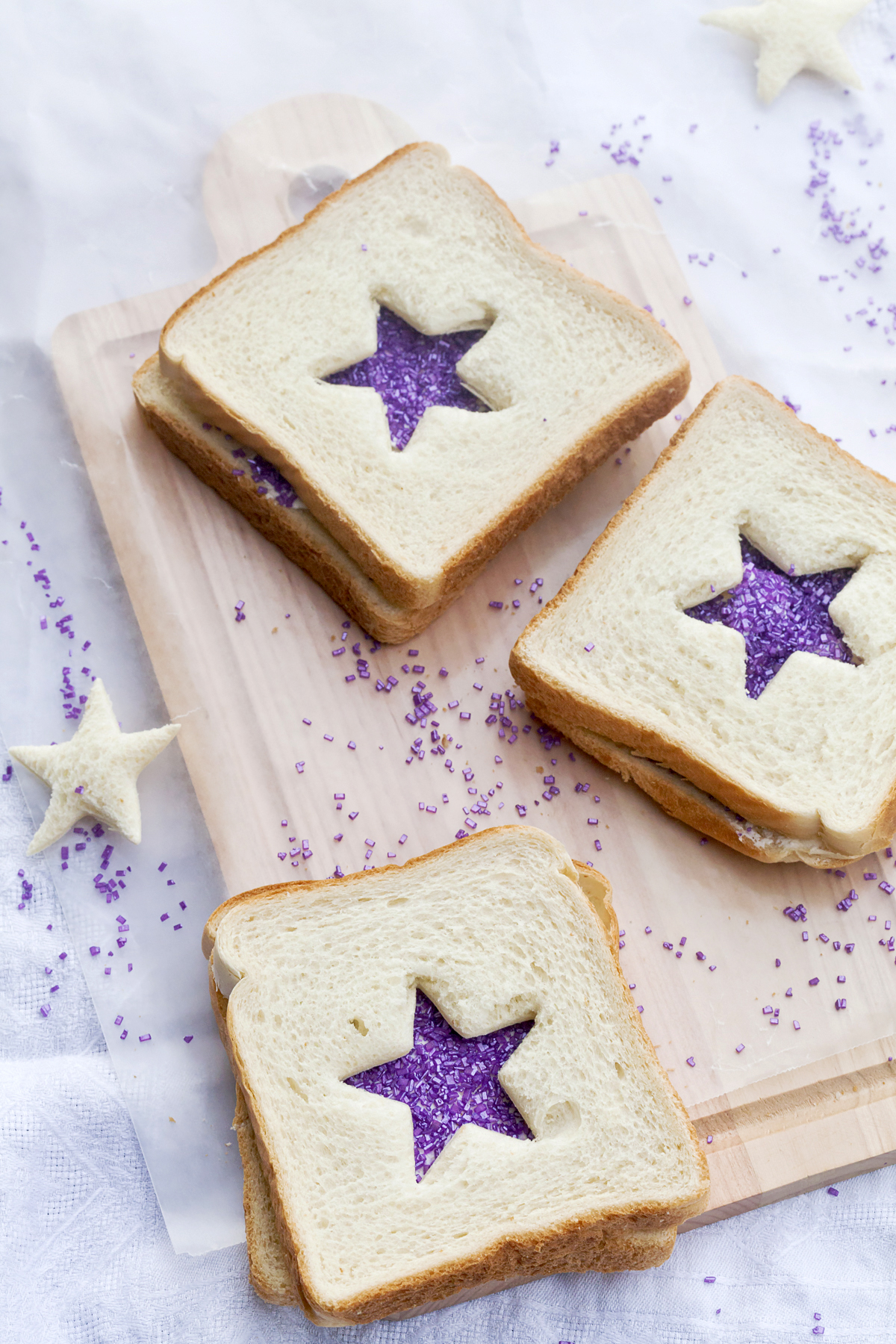 fairy bread sandwiches with Sprinkles and purple star cutouts